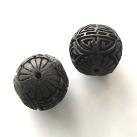 Bead, cinnabar, black, 22mm, carved round. Pkg of 2.