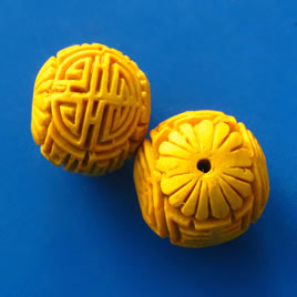 Bead, cinnabar, yellow, 22mm, carved round. Pkg of 2.