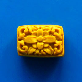 Bead, cinnabar, yellow, 17x23x9mm, carved. Pkg of 2.