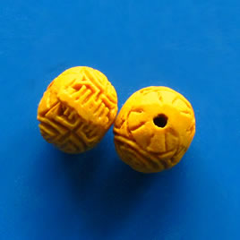 Bead, cinnabar, yellow, 12mm, carved. Pkg of 7.