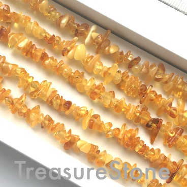 Bead, Amber, small chips. 15 inch strand.