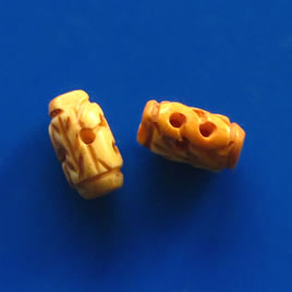 Bead, antiqued bone, 12x7mm carved tube. Pkg of 4
