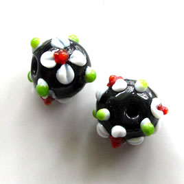 Bead, lampworked glass, black, 12x14mm bumpy rondelle. Pkg of 5.