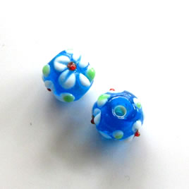 Bead, lampworked glass, blue, 9x11mm bumpy rondelle. Pkg of 7.