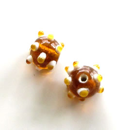 Bead, lampworked glass, amber, 10x13mm bumpy rondelle. Pkg of 7.