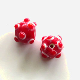 Bead, lampworked glass, red, 8x11mm bumpy rondelle. Pkg of 7.