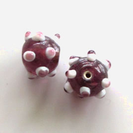 Bead, lampworked glass, purple, 10x13mm bumpy rondelle. Pkg of 7