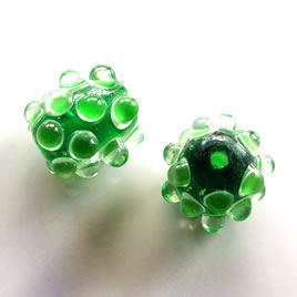 Bead, lampworked glass, green, 22mm bumpy. Sold individually.
