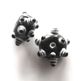 Bead, lampworked glass, black, 8x17mm bumpy rondelle. Pkg of 4
