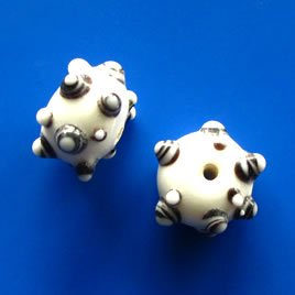 Bead, lampworked glass, white, 9x17mm bumpy rondelle. Pkg of 4