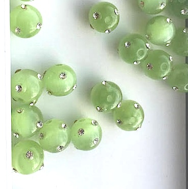 Bead, cat's eye glass w rhinestone, 8mm round, green. Pkg of 5