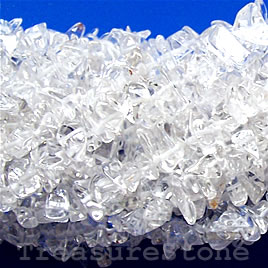 Bead, crystal quartz (natural), chip. Sold per 36-inch strand.