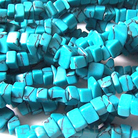 Bead, dyed howlite, chips. Sold per 36-inch strand.