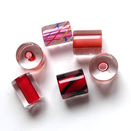Bead, Fire Design cane glass, red, about 8x10mm tube. Pkg of 3.