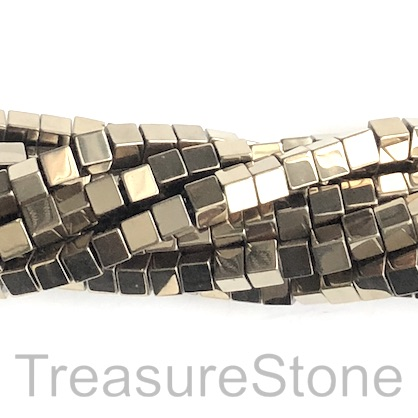 Bead, hematite, pyrite gold, 6mm cube. 16-inch, 68pcs