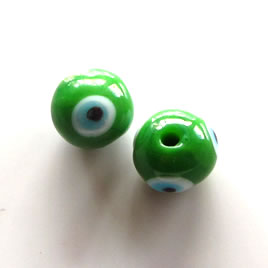 Bead, lampworked glass, green, 10mm round, evil eye. Pkg of 10.
