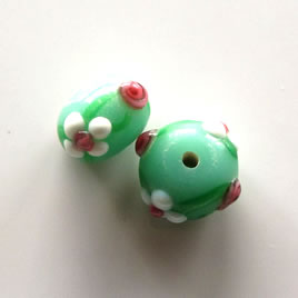 Bead, lampworked glass, green, 14x9mm rondelle. Pkg of 8.