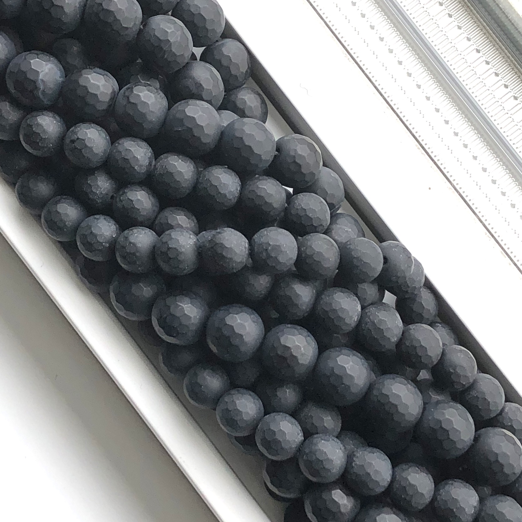 Bead, black Onyx, 10mm, faceted, matte, frosted, 15.5 inch, 38