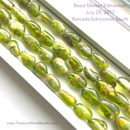 Bead, peridot, about 12 to 14mm nugget. 16-inch strand.