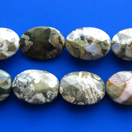 Bead, rhyolite, 13x18mm faceted oval. 16-inch strand.