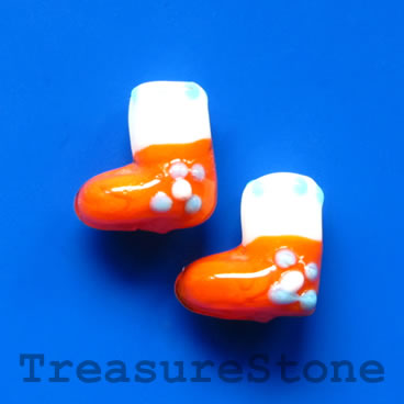 Bead, lampwork, orange, 13mm Christmas stockings. Pkg of 5.