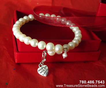 Pearl (6 to 7mm) bracelet (7 to 7.5 inches).