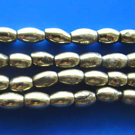 Bead, pyrite, 4x6mm oval. 16 inch strand.